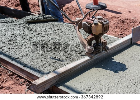 Construction process in the making of a freshly pored cement sidewalk. - stock photo