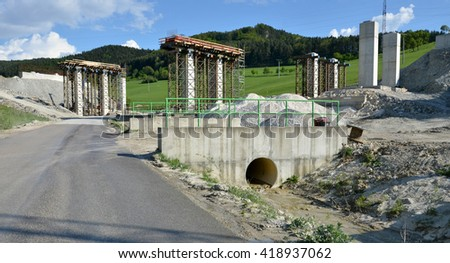 Construction process of pillars, which are going to be a part of new highway - stock photo