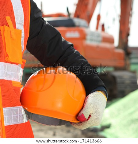 construction safety concept with  excavator background - stock photo