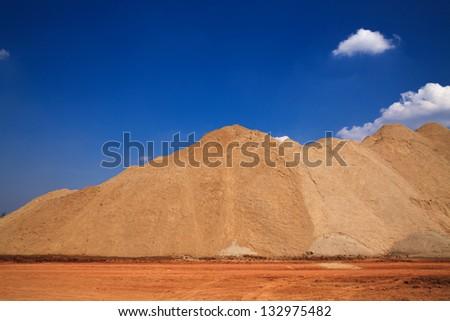 Construction sand mound quarry - stock photo