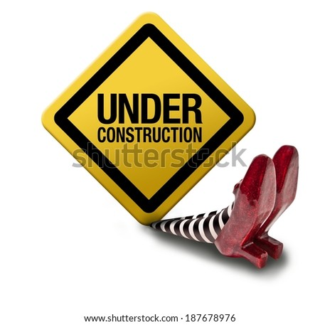 Construction sign fallen on the wicket witch - stock photo