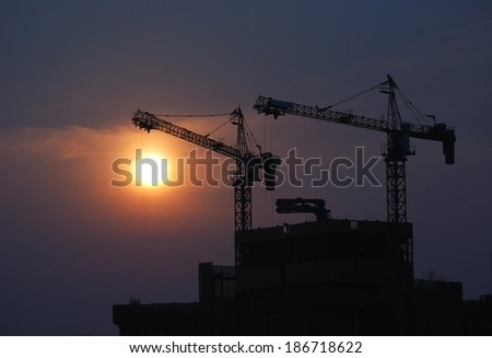 Construction site against sunset - stock photo