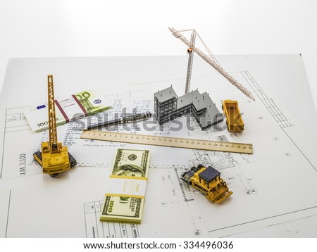 construction site and everything you need to build, money, calculations, equipment - stock photo