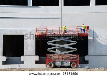 Construction site and lifting machine closeup - stock photo