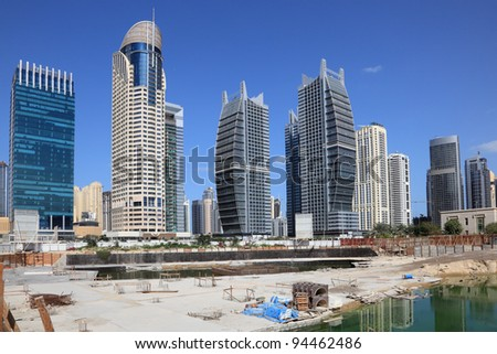 Construction site at Jumeirah Lake Towers in Dubai, United Arab Emirates - stock photo