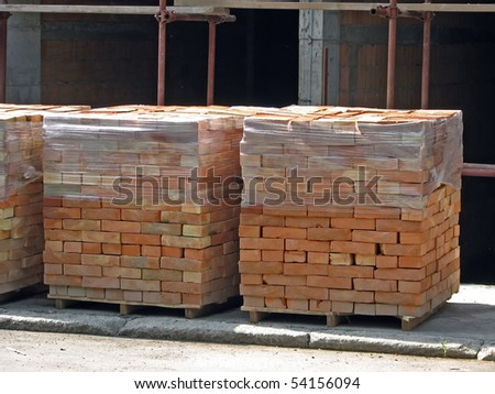 Construction site. Bricks from construction site. Pile of red bricks. - stock photo