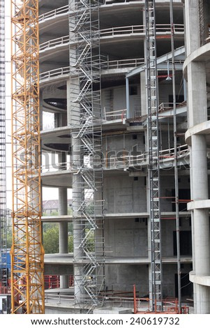 Construction site; closeup of a skyscraper under construction - stock photo