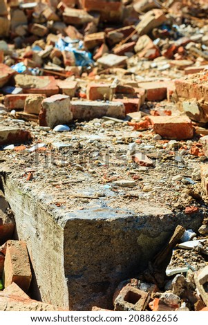 Construction site. Closeup of stack of old grunge destroyed damaged bricks. Industry. - stock photo
