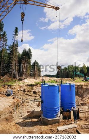 Construction site, construction machinery, tanks, cistern bulldozer, excavation, factory - stock photo