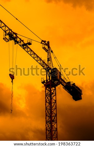 Construction site crane - stock photo