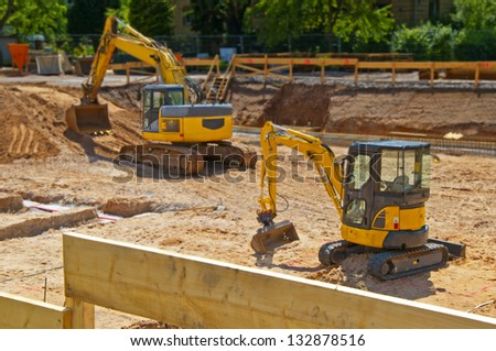 Construction site foundation with excavator - stock photo
