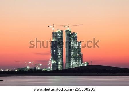 Construction site in Abu Dhabi at dusk. United Arab Emirates - stock photo