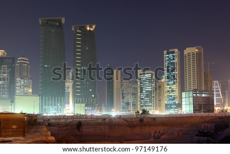 Construction site in Doha downtown at night, Qatar - stock photo
