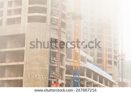 Construction site in fog - stock photo