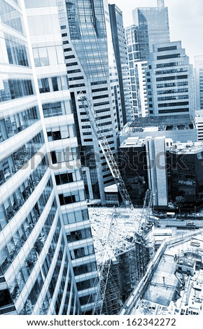 Construction site of a modern skyscraper in Singapore  - stock photo