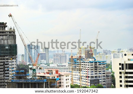 Construction site of a modern skyscrapers in Singapore  - stock photo