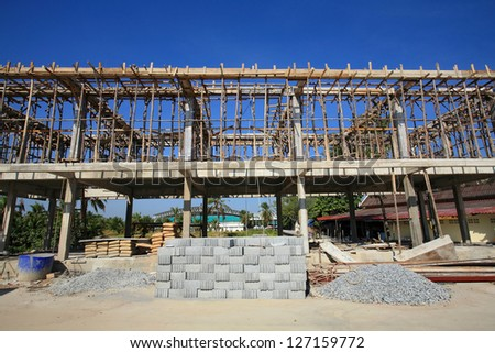 construction site of concrete building with wooden frames - stock photo
