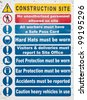 construction site sign with safety notices hanging on a wooden wall - stock photo