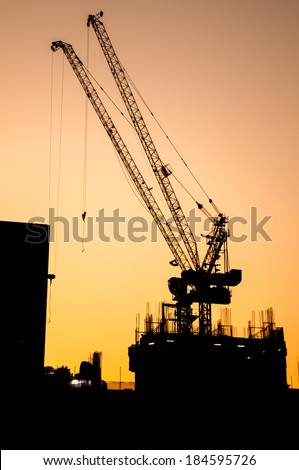 Construction site - silhouette built crane structure industry