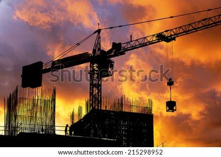 Construction site silhouette on sunset sky - stock photo