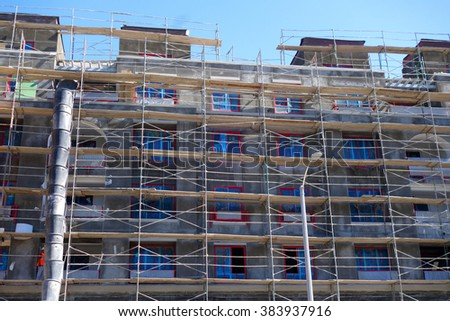 construction site with building and scaffolding