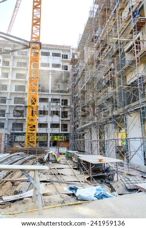 Construction site with crane and scaffold - stock photo