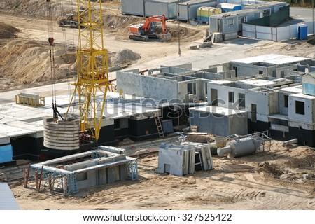 Construction site with crane, bulldozers and excavators - stock photo