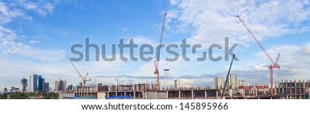 Construction site with crane worker and building as panorama - stock photo
