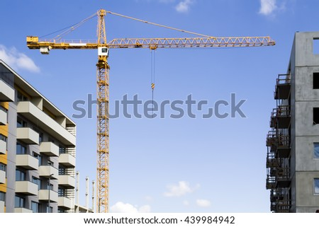 Construction site with cranes against blue sky. New high-rise buildings. - stock photo
