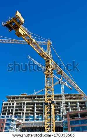 Construction site with cranes against blue sky. Vancouver, Canada. - stock photo