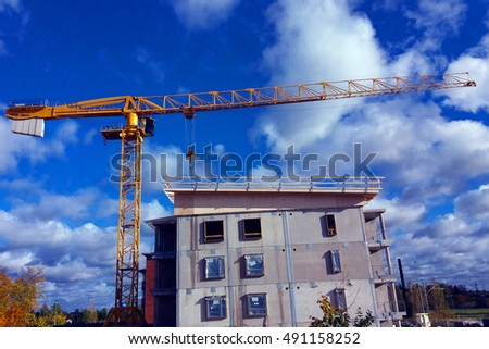 Construction site with tower crane.