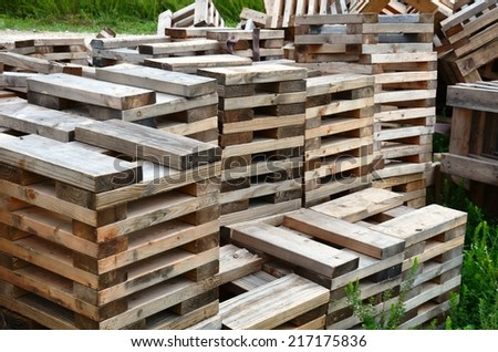 Construction site wooden support cubes for modular building units - stock photo