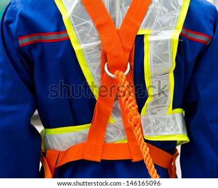 construction site worker with safety rope. - stock photo