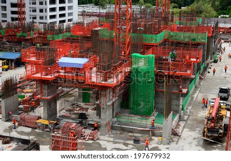 Construction site workers. - stock photo