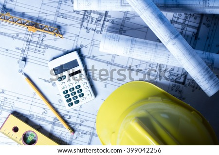 Construction theme, level, ruler, calculator, blueprints rolls, hard hat and pencil - stock photo