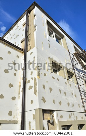 Construction - thermal insulation with polystyrene foam - stock photo