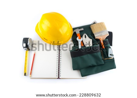 construction tools and blank notepad on a white background - stock photo