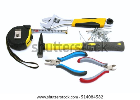 Construction tools and instruments - hammer, nail, pliers and tape measure.  Isolated on white background