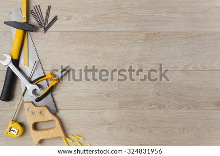 Construction tools on a wood background. - stock photo