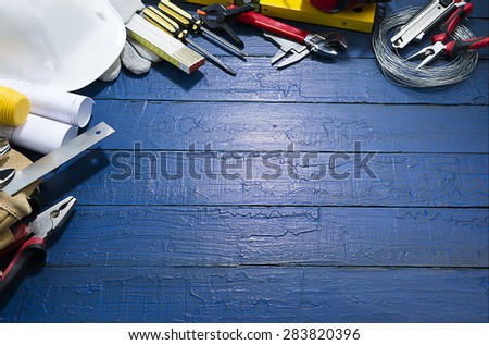 Construction Tools on Blue Wood - stock photo