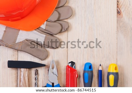 Construction tools on wooden board top view. - stock photo