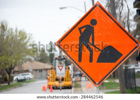 Construction traffic sign warning in construction site in a city or urban area - stock photo
