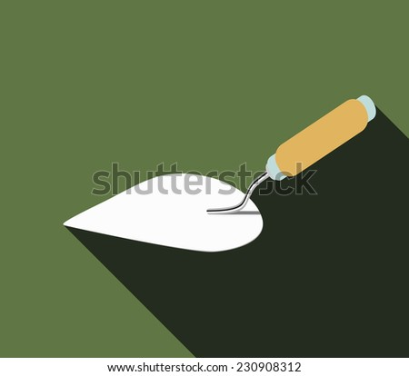 construction trowel with wooden handle - stock photo