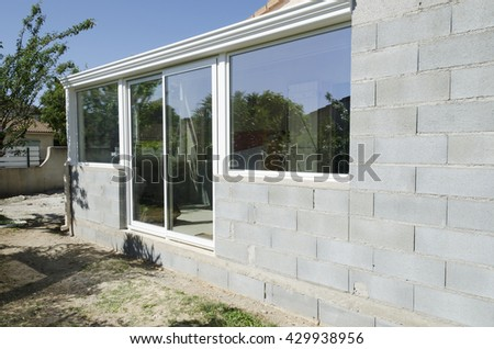 construction veranda with windows and concrete