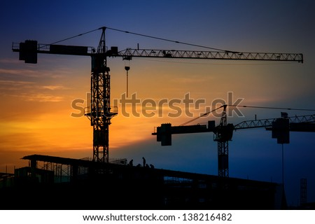 Construction with cranes at evening - stock photo