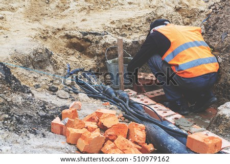 Construction work, construction worker carries out the masonry bricks