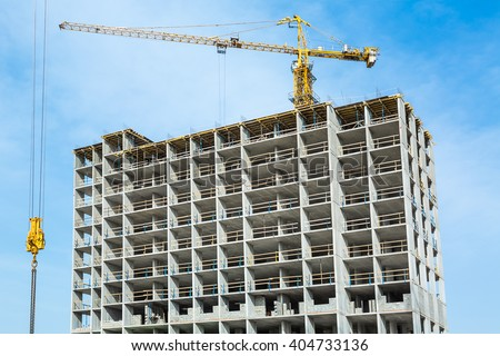 Construction work site and high-rise crane/Construction work and building crane. Construction work site and high-rise crane/Construction work and building crane. - stock photo