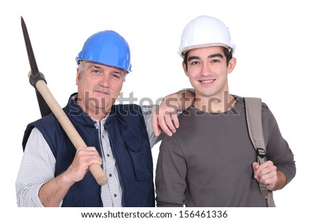Construction worker and his grandson. - stock photo