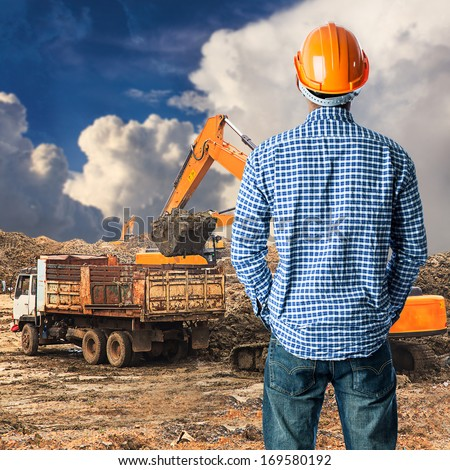 Construction worker at construction site in blue sky  - stock photo