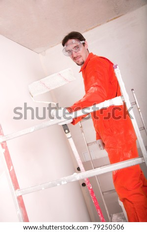 Construction worker at work, preparing to paint